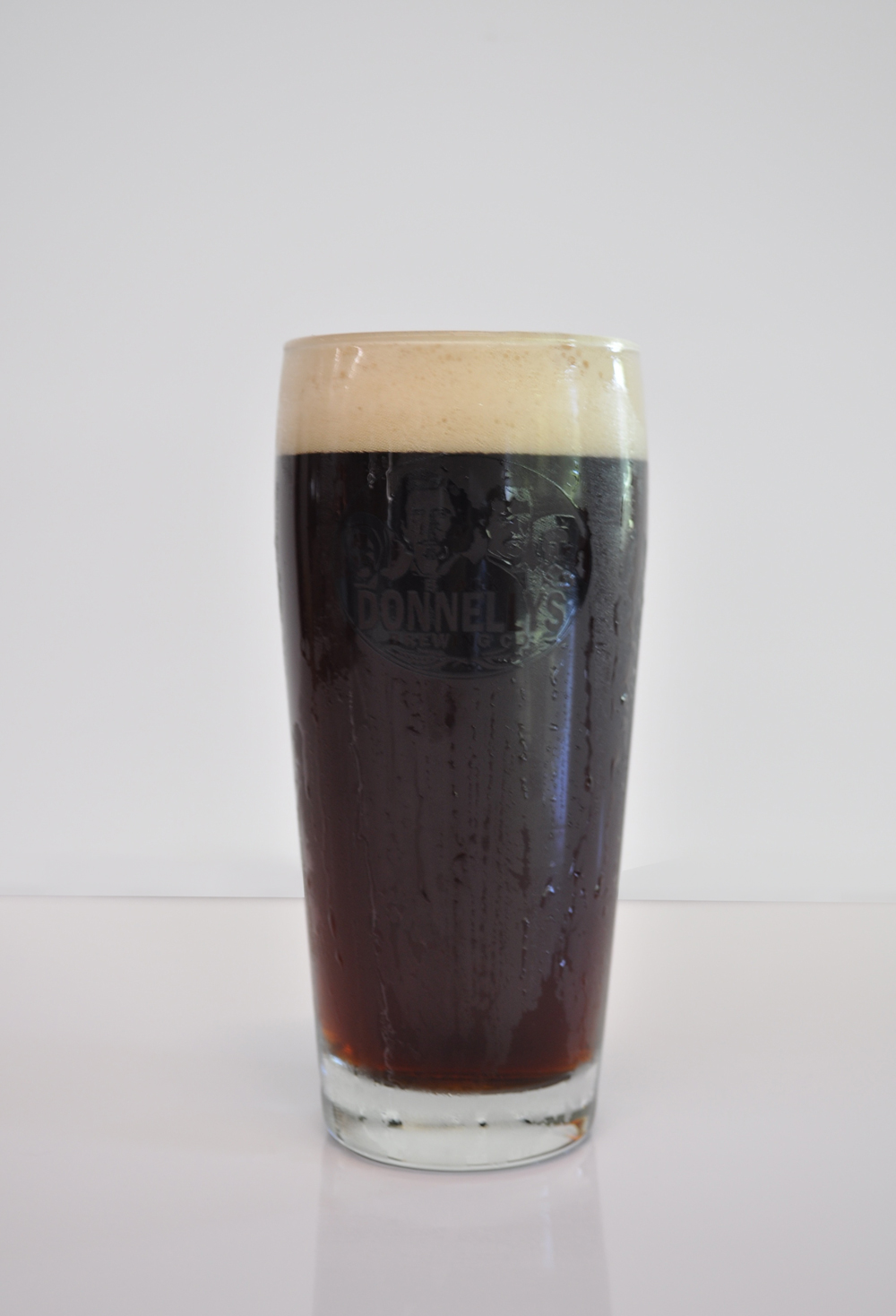 A refreshing pint of Black Donnellys Brewing Company Roman Line Lager beer.